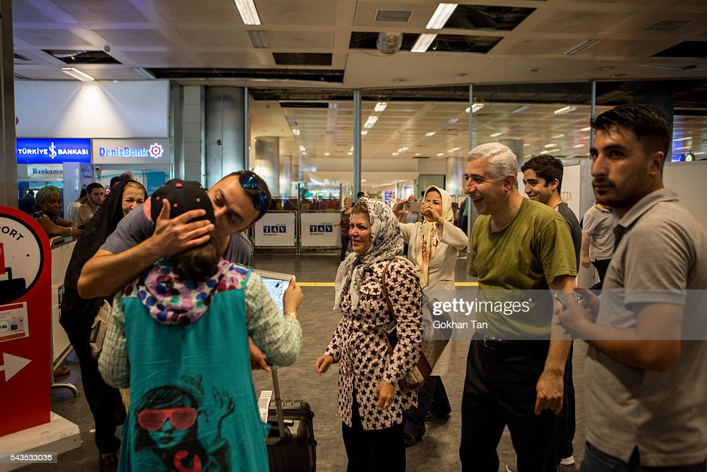 Passengers meet with their relatives at the international arrival terminal at the country's largest airport, Istanbul Ataturk, following yesterday's blast on June 29, 2016 in Istanbul, Turkey. Three suicide bombers opened fire before blowing themselves up at the entrance to the main international airport in Istanbul yesterday. The Istanbul Governor's Office says 41 people have been killed, 37 of the victims have been identified, including 10 foreign nationals and three people with dual citizenship. More than 230 people were wounded but 109 have been discharged from hospitals in the deadly suicide bombing attack in Istanbul's Ataturk airport blamed on the Islamic State group.