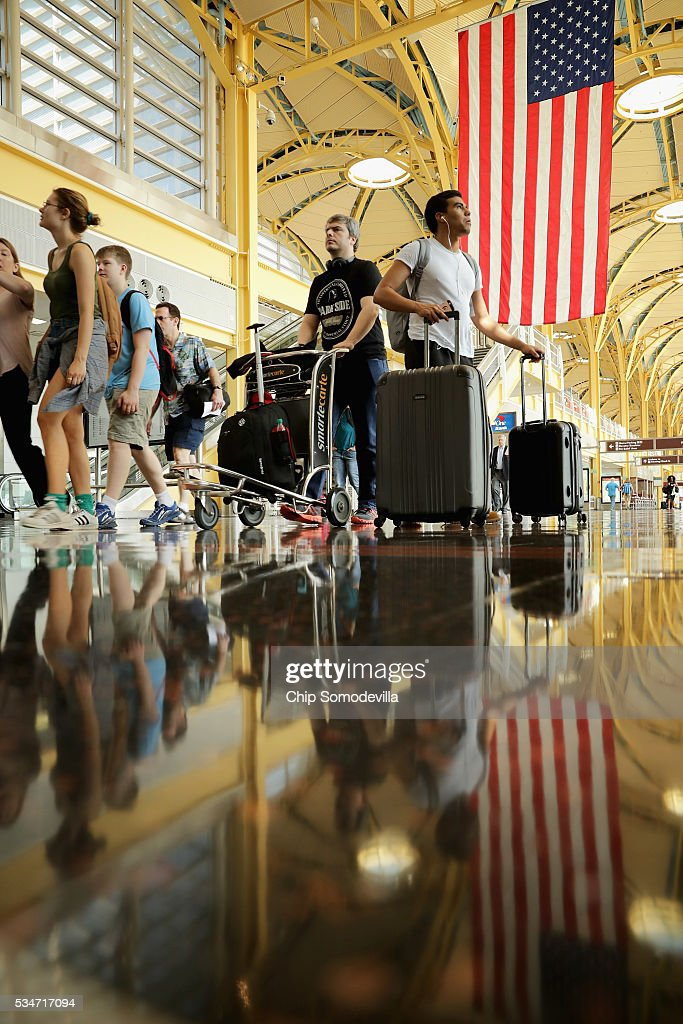Passengers move through Ronald Reagan National Airport May 27, 2016 in Arlington, VA. According to AAA, 'more than 38 million Americans will travel this Memorial Day weekend. That is the second-highest Memorial Day travel volume on record and the most since 2005. Spurred by the lowest gas prices in more than a decade, about 700,000 more people will travel compared to last year.'