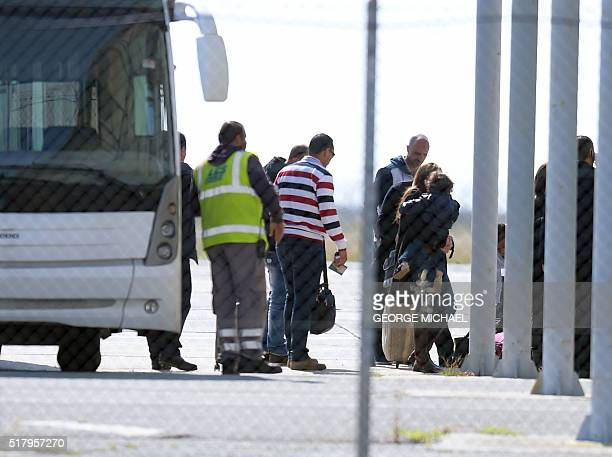 Passengers of an EgyptAir Airbus A320 which was hijacked and diverted to Cyprus leave a bus at Larnaca airport after disembarking on March 29 2016 A...