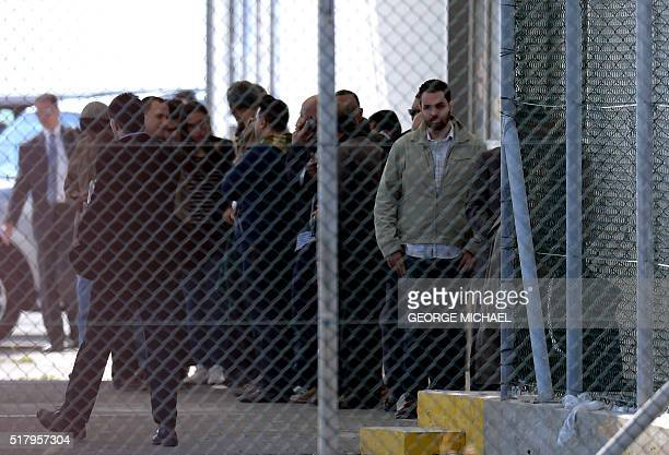 Passengers of an EgyptAir Airbus A320 which was hijacked and diverted to Cyprus stand at Larnaca airport after disembarking on March 29 2016 A...