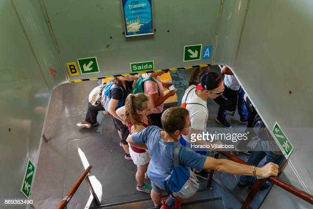 Passengers of Cais do Sodre ferry wait to disembark at terminal on October 31 2017 in Lisbon Portugal Cais do Sodre ferries cross the Tagus River to...