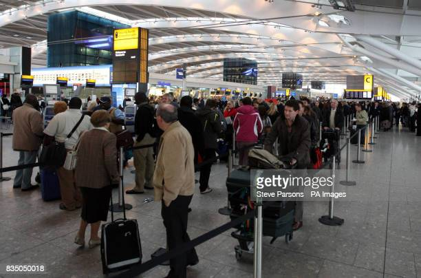 Passengers of cancelled flights queue in Terminal Five of Heathrow Airport after the snow closed both the runways for a short time