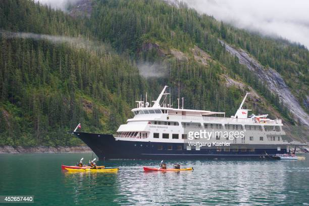 Passengers of cruise ship Safari Endeavour sea kayaking at Fords Terror Endicott Arm Tongass National Forest Alaska USA