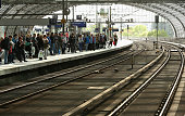 Passengers of German state rail carrier Deutsche Bahn wait for less frequent trains at the Hauptbahnhof or main train station during a weeklong...