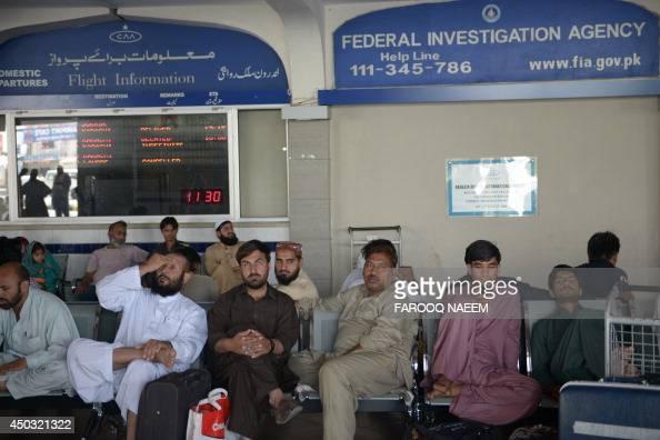 Passengers of Karachibound Pakistan International Airline flights wait after delays at the Benazir Bhutto International Airport in Islamabad on June...