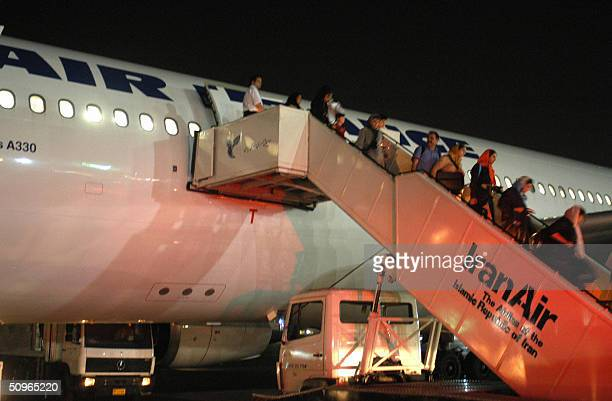 Passengers of ParisTehran flight of Air France take the stairs down to Tehran's Mehrabad airport late 15 June 2004 The three weekly flights from...