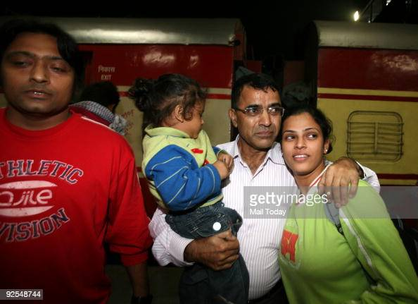 Passengers of the BhubaneswarNew Delhi Rajdhani which was hijacked on Tuesday by Maoists are reunited with their relatives after the train arrived at...
