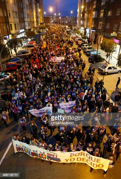 Passengers of the 'Freedom Train' and local residents take part to a march toward Spain's ruling PP national convention held in Valladolid to protest...