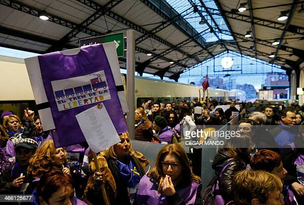Passengers of the 'Freedom Train' react during a stop at Campo Grande station in Valladolid on January 31 2014 Proabortion groups organized a...