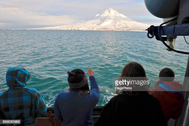 Passengers of the M/V Milo look at the Northeast flank of Mt Augustine