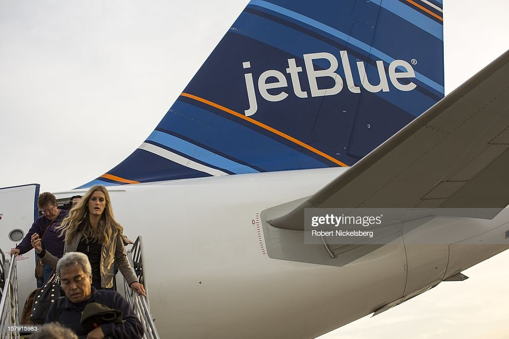 Passengers on a Jet Blue Airways flight disembark December 4, 2012 at the Long Beach, California airport. Jet Blue Airways fly Airbus A 320 planes.