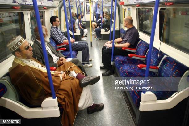 Passengers on a London Underground train about to pull into Kings Cross Station