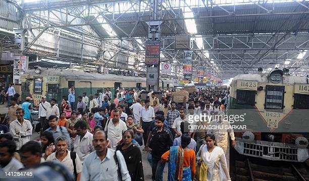 Passengers on a train platform at a station in Kolkata on March 15 2012 India's railway minister said he aimed to reduce deaths to zero on the...