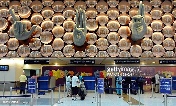 Passengers on an Air India flight from New York pass through immigration counters at terminal T3 of Indira Gandhi International airport in New Delhi...