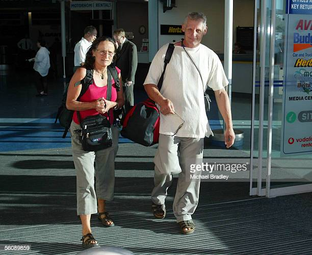 Passengers on flight SQ286 Robin and Paul Mason make their way to a bus to be taken to a local hotel after the Singapore Airlines flight SQ286 made...