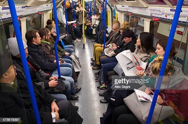 Passengers on London Underground carriage UK
