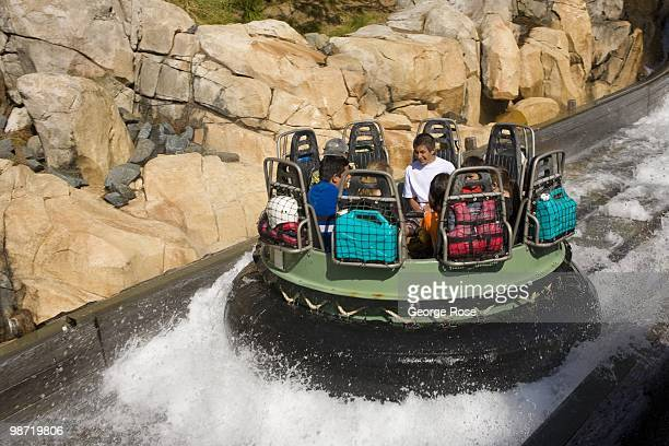 Passengers on the Grizzly River Run thrill ride in Disney's California Adventure Park splash through water as seen in this 2010 Anaheim California...