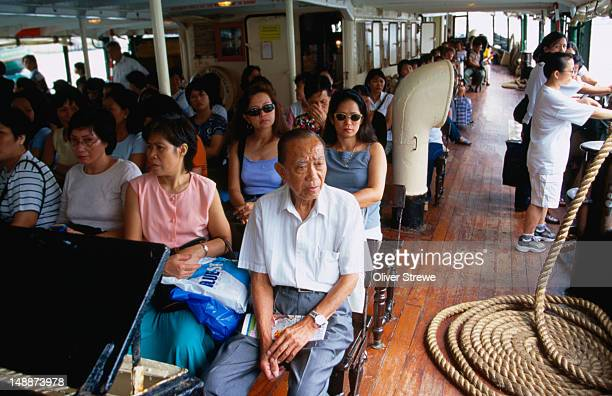 Passengers on the Star Ferry, an essential mode of transport for commuters.