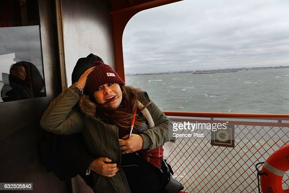Passengers on the Staten Island Ferry struggle with the wind as New York City prepares for a nor'easter storm on January 23 2017 in New York City The...