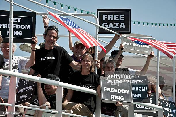 Passengers on the US Gazabound boat 'The Audacity of Hope' prepare to set sail from Athens on June 30 2011 to join the flotilla to Gaza Passengers on...