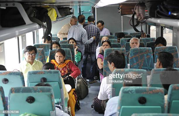 Passengers onboard Indore bound Double Decker AC Express at Bhopal station on last day of its run on August 12 2014 in Bhopal India Operation of...