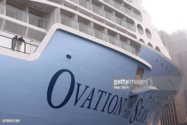 Passengers onboard the MS Ovation of the Seas look out from their balcony as it docks for the first time at Overseas Passenger Terminal on December...