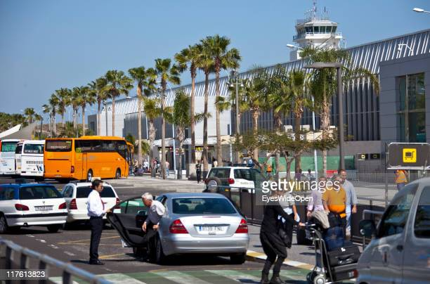 Passengers outside of the Airport Reina Sofia on March 25 2011 in Tenerife Spain Tenerife is the biggest of the canary islands and because of its...