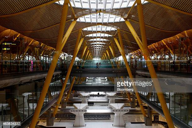 Passengers pass through a terminal building at Madrid Barajas airport operated by Aena SA in Madrid Spain on Wednesday Feb 18 2015 Aena rose in its...
