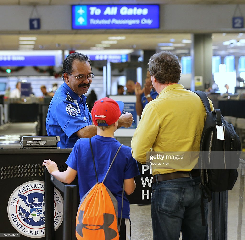 Passengers pass through a TSA security check point at the Salt Lake City international Airport on November 27, 2013 in Salt Lake City, Utah. A wintry storm system that is covering much of the nation is threatening to wreak havoc on holiday travel .