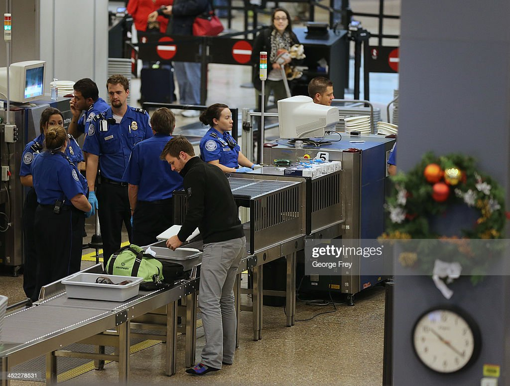 Passengers pass through security at the Salt Lake City international Airport on November 27, 2013 in Salt Lake City, Utah. A wintry storm system that is covering much of the nation is threatening to wreak havoc on holiday travel .