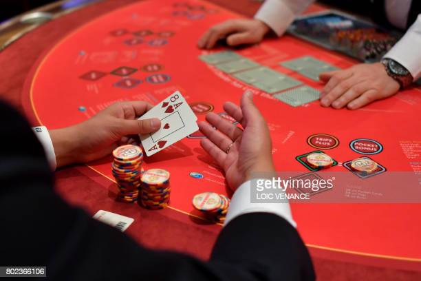 Passengers play Black Jack at the casino aboard the British cruise liner RMS Queen Mary 2 on June 27 2017 as it sails in the Atlantic ocean during...