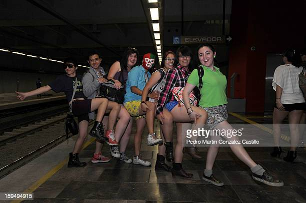 Passengers pose without pants in the subway to celebrate 'No Pants Day' on January 13 2013 in Mexico City Mexico