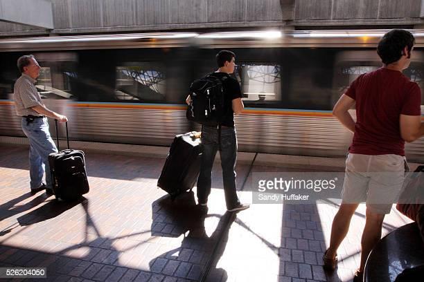 Passengers prepare to board a MARTA subway train at Atlanta Hartfield International Airport in Atlanta GA on Friday July 30 2010