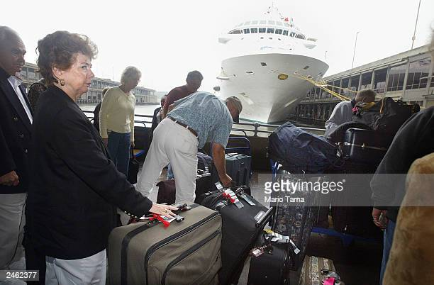 Passengers prepare to board the ocean liner Regal Princess after it was cleaned following an outbreak of a Norwalktype virus September 4 2003 in New...
