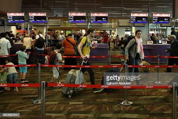 Passengers prepare to checkin at AirAsia counters at Changi Airport Terminal 1 on December 29 2014 in Singapore AirAsia announced that flight QZ8501...