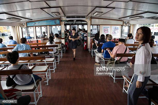 Passengers prepare to disembark at the Wanchai pier after crossing Victoria Harbour on the Star Ferry on June 6 2014 in Hong Kong The ferry which...