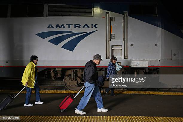 Passengers pull luggage past an Amtrak train at Union Station in Chicago Illinois US on Thursday Oct 8 2015 The head of Amtrak warned Congress that...