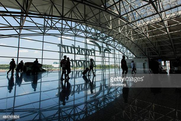 Passengers pull their luggage inside terminal 2 of Frankfurt Airport operated by Fraport AG in Frankfurt Germany on Friday Aug 21 2015 The Greek...