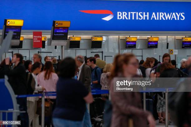 Passengers queue at checkin at the British Airways terminal Terminal 5 at London Heathrow Airport in London UK on Tuesday May 30 2017 British...