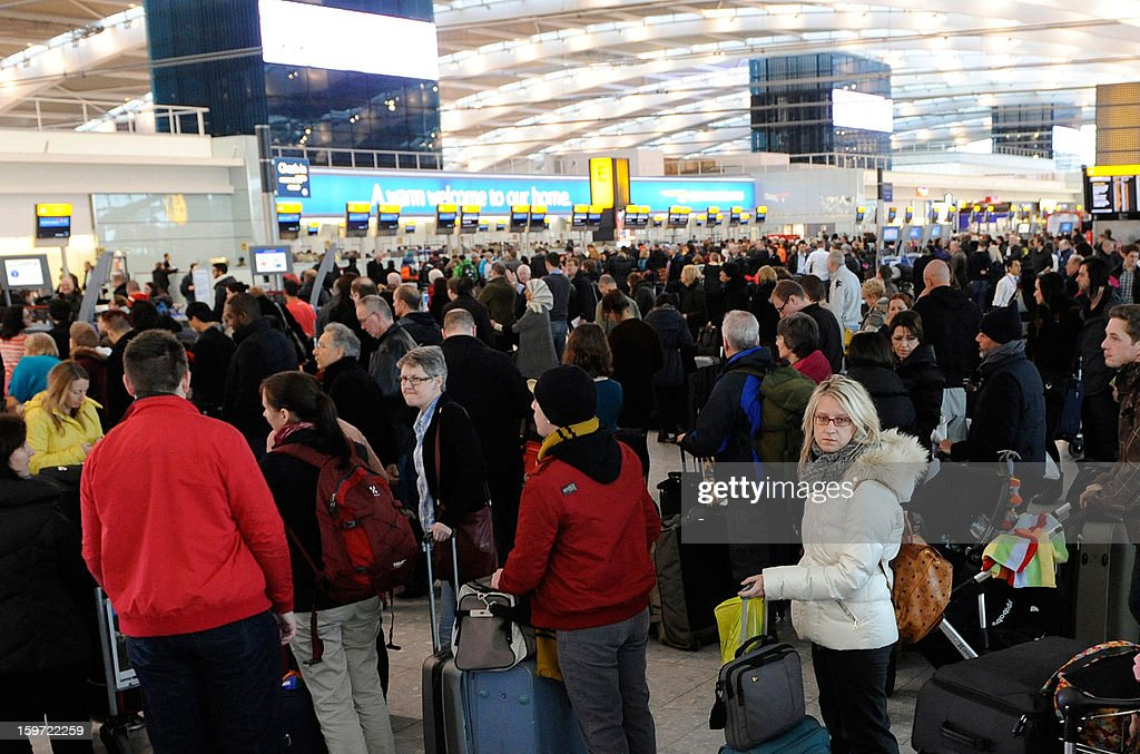 Passengers queue at for the check-in desks at a busy Heathrow airport in west London on January 19, 2013 after hundreds of flights were cancelled due to severe cold weather and snow. Passengers were forced to sleep on the floor at London's Heathrow Airport overnight, media said Saturday, after heavy snow grounded hundreds of flights and left thousands of people stranded. A spokesman for the airport, one of the busiest in the world, said a further 100 flights had been cancelled on Saturday morning, on top of about 400 that were grounded Friday by the bad weather sweeping Britain.