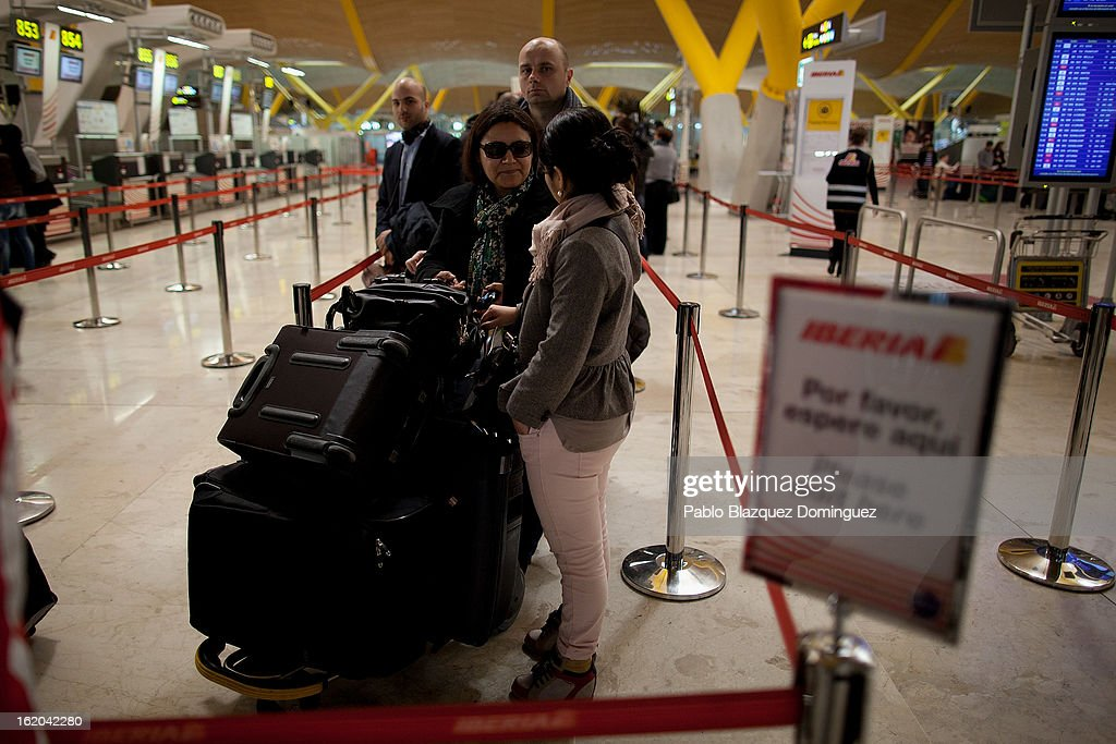 Passengers queue at Iberia's customer care office before a protest of Spanish Airline Iberia staff against job cuts at Barajas Airport on February 18, 2013 in Madrid, Spain. Today is the first of a five day strike held by Iberia cabin crew, maintenance workers and ground staff in response to the planned loss of 3,800 jobs. The strike has resulted in the airline having to cancel 400 flights this week with unions planning a further 5 day strikes within a month.