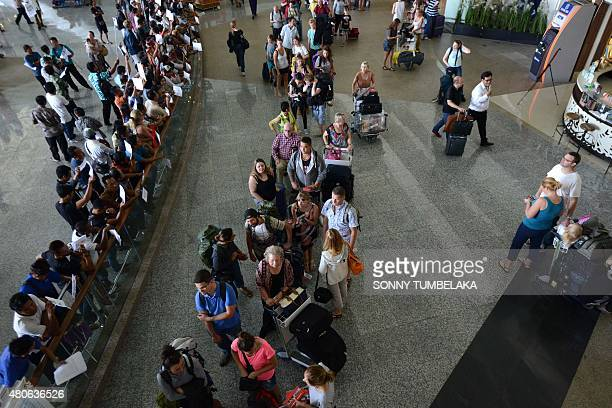 Passengers queue at Ngurah airport in Denpasar on 14 2015 Indonesian authorities at Bali's international airport were fighting to clear a backlog...