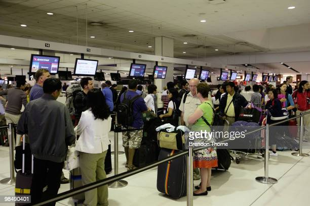 Passengers queue for a special flight bound for Singapore as flights are delayed and cancelled following the eruption of iceland's Eyjafjallajokull...