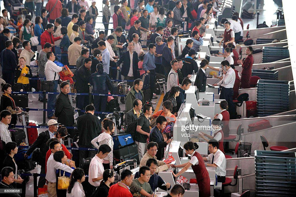 Passengers queue to check in at Beijing Capital International Airport on September 29 in Beijing, China. 'Golden Week' is a national holiday that traditionally takes place from September 29th to October 5th.