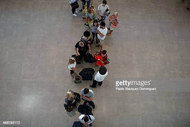 Passengers queue to checkin for the the first commercial flight taking off at Castellon airport on September 15 2015 near Castellon de la Plana in...