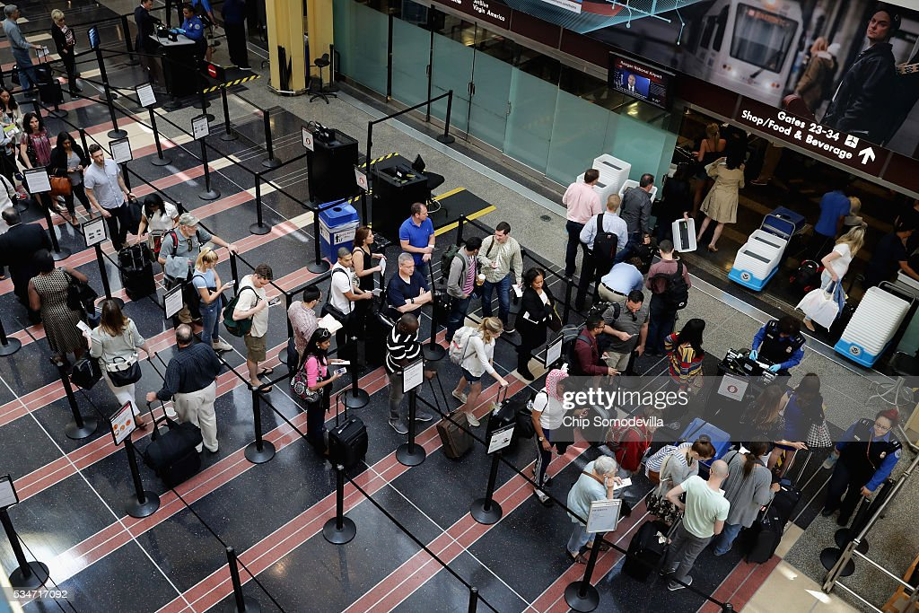Passengers queue up outside a Transportation Security Administration checkpoint at Ronald Reagan National Airport May 27, 2016 in Arlington, VA. According to AAA, 'more than 38 million Americans will travel this Memorial Day weekend. That is the second-highest Memorial Day travel volume on record and the most since 2005. Spurred by the lowest gas prices in more than a decade, about 700,000 more people will travel compared to last year.'