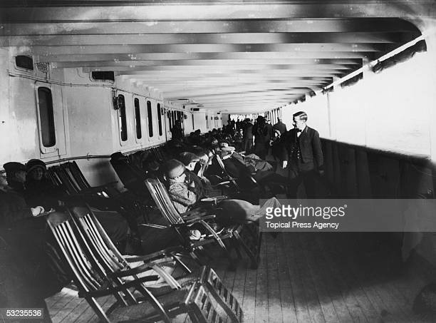 Passengers relax in deckchairs on the saloon deck of the Cunard liner Lusitania June 1912 The ship was sunk by a German submarine in 1915
