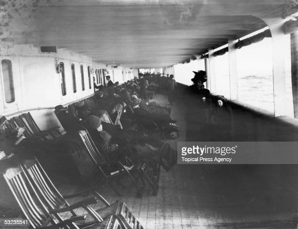 Passengers relax in deckchairs on the saloon deck of the Cunard liner Lusitania June 1912 The ship was later sunk by a German submarine in 1915