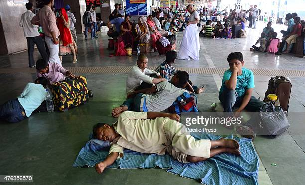 Passengers rest at a platform as they wait for a train during a hot day at Allahabad junction The death toll from the blistering heat wave in India...