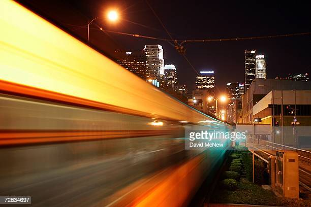 Passengers ride a Metro Link train at a station near highrise loft buildings under construction an outgrowth of the current development of the...